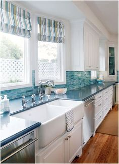 Love the huge double farmhouse sink! Watery Blue Green Tiles and Striped Roman Shades lend a coastal feel to this White Kitchen. - House of Turquoise: Noelle Interiors - DIY Home Decor Beach House Kitchens, Home Kitchens, Coastal Kitchens, Tiny Kitchens, Kitchen Redo, New Kitchen, Kitchen Ideas, Kitchen Cabinets, Awesome Kitchen