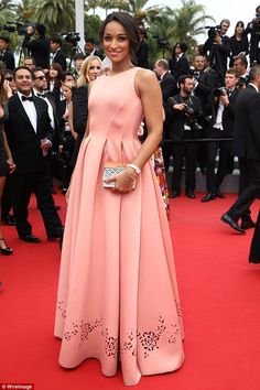 Pretty in pink: French beauty model Cindy Fabre looked chic in a peachy pink gown with a l...