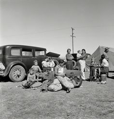 "March 1937. ""Four families, three of them related with 15 children, from the Dust Bowl  in Texas in an overnight roadside camp near Calipatria, California."""