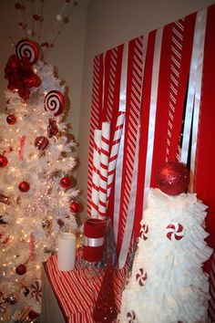 Big peppermint sticks out of wrapping paper tube! With the big styrofoam peppermints, these would be cute on the porch.