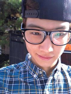 JB :) So cute with glasses and a snapback