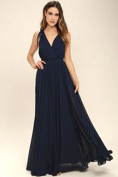 Every twirl you take in the Dance the Night Away Navy Blue Backless Maxi Dress will be absolutely magical! Woven poly forms wide straps, with tying detail and hidden no-slip strips, that flow into a surplice bodice. A sweeping maxi skirt falls below a backless silhouette and fitted waist. Hidden back zipper/clasp.