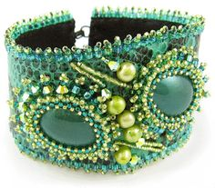 """""""Emerald Forest Bead Embroidery Bracelet"""", The stone is set by the bright turquoise patterned leather; teardrop vintage """"miracle"""" cabochons are poised on the diagonal in the center area. Pearls, seed beads, and bicone crystals add interest to the teardrops, by Ann Benson ..."""