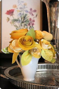 DIY Rolled Paper Flowers - I love this!  This is beautiful.  I did some small more colorful flowers like this and made a topiary out of it.  I'm going to try this more elegant way.