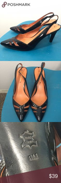Via Spiga black patent leather heels size 9 These heels are a black patent leather and in excellent condition they have been gently used. They are size 9. The only sign of wear is the small white mark on the back of the right heel. The heels are about 3 inches tall. Via Spiga Shoes Heels