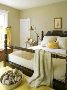 This country-style bedroom combines soft shades of khaki, cream and yellow.