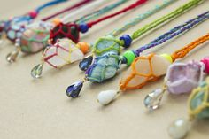 DIY Netted Macrame Stone Necklace Tutorial from Quiet Lion Creations. These are so colorful and fun. The macrame tutorial for these netted stone necklaces is really detailed and well photographed. For more netted, wrapped and macrame stones DIYs see...
