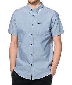 Instantly improve any outfit when you throw on this stylish slim fit button up design in a distant blue oxford colorway and a classic welt pocket on the left chest.