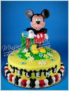 Mickey Mouse cake. I love the details around the bottom of the cake!