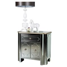 Mirrored side table.  Product: Side tableConstruction Material: Mirrored glassColor: Silver...