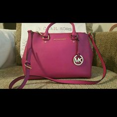 Authentic Michael Kors Sutton Handbag Fuschia Pink Excellent used condition, carried once, gold hardware,  and comes with dust bag. Michael Kors Bags Shoulder Bags