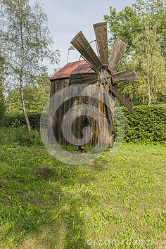Old wooden windmill in open-air museum in Nowy Sącz and storm clouds  . Poland