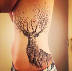 A stag with flowers abloom. | 31 Stunning Floral Tattoos To Get You Ready For Spring
