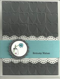 lacy border and good use of heart embossing folder.