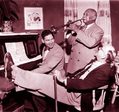 "1953. Memphis. From The Commercial Appeal, December 1, 1953:  ""BIRTH OF BLUES—W.C. Handy and his golden trumpet yesterday gave the world ""The Newspaperman's Blues,"" a song written for a newspapermen's club here. Accompanying the famed musician at the piano is Berl Olswanger, star on WMCT, The Commercial Appeal's television station, and looking on is Paul Flowers, columnist on this newspaper. www.BerlOlswanger.com"