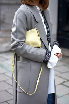 More on www.offwhiteswan.com  Layering Streetstyle, Edited Long Wool Coat, Céline Triobag Yellow, Houndstooth Blazer H&M Trend, fringed Dednim Zara, Fur Sneakers Moncler lookalike #offwhiteswan #swantjesoemmer