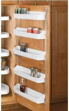 Simplify Your Organization: Hold your spices in places on a shelf mounted on the inside of your cabinet door. Good for RVs or your kitchen. (Camping Hacks Toiletries)