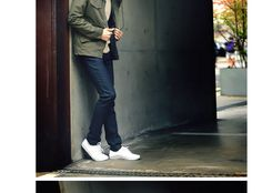 army green jacket pairing with blue jeans