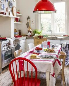Série Ooh La La da semana . inviting vintage-look kitchen. pops of red! love the painted red chair and the red stripes  white tablecloth!