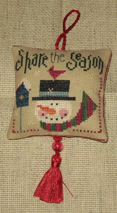 Design: Share the season by Lizzie Kate Fabric: 30 count Linen  Threads:GAST, WDW, DMC threads  Finishing: Chrsitmas ornament Stitched by M...