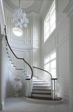 Unbelievable white entry foyer and curved staircase, fabulous trim. Maybe change the floor color n the wall for my entry n stairs Curved Staircase, Grand Staircase, Staircase Design, Staircase Ideas, White Staircase, Spiral Staircases, Modern Staircase, Staircase Molding, Luxury Staircase