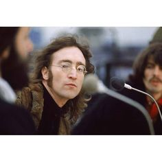 John Lennon during the Beatles' last ever public performance on the rooftop of the Apple offices on Savile Row, London 1969