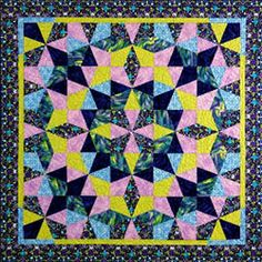 Arctic Spring - 25 block Kaleidoscope Puzzle Quilt. Template-free technique by Maggie Ball.