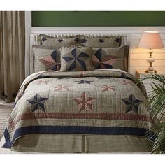 The Vincent Bedding Collection by VHC Brands. The Vincent collection combines heirloom quality with superior comfort. Featuring prominently displayed navy blues, khaki, and deep reds with plaid 5-point stars creating a Trip Around the World pattern.