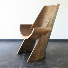 Nimosi chair in pequi wood sculpted from a canoe from the Pataxos natives south of Bahia. Designed by Hugo Franca Brazil 2006.via randcompanynyc.jpg