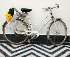 This is a photo of what my summer will be like. Including self-bought flowers. #bike