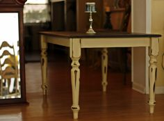 Ebony Stained table top, base and legs painted cream, distressed, stained and sealed.