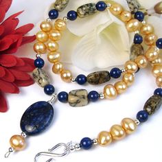 Love this! Blue Lapis Gold Pearl Necklace African Opal Sterling Silver Swarovski | PrettyGonzo - Jewelry on ArtFire