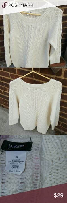 J. Crew ivory sweater L- XL Excellent sweater with cable with three-quarter sleeves which is really smaller than the XL it is labeled. I think it fits a small as it measures 18 inches under the arms. Great prelived of condition. J.Crew Sweaters Crew & Scoop Necks
