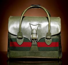 From the 1950's, this is another Gucci archive desing, the Web Duffle Bag