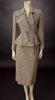 Dress Suit 1945. Such alluring cuts, but would personally prefer a solid color material to this heather grey.
