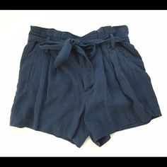 Navy Pleated Shorts M. Gently Worn. Pockets. Pleated details. Size M. Mid Rise, Sits a little above hip. Pair it with a crisp white shirt for a clean, classic look. Shorts