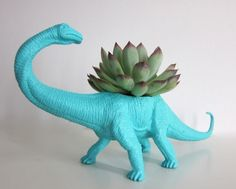 old plastic toys... painted and made into a planter... Awesome.