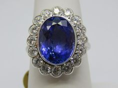 Natural Tanzanite 7.51ct. & Diamonds 1.50ct.18k. White Gold Ring Size: O