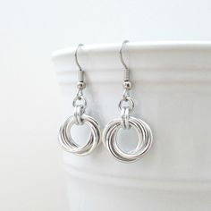 Silver Love Knot chainmaille earrings - 10.00 Classic. Timeless. Beautiful in their simplicity, these chainmaille Love Knot earrings can be worn by women of all ages. Large 16 gauge silver aluminum jump rings were woven together to create the swirl look.