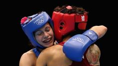 Sofya Ochigava (L) of Russia celebrates her victory against Adriana Araujo of Brazil during the Women's Light (60kg) Boxing semifinals on Day 12 of the London 2012 Olympic Games at ExCeL