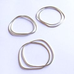 Organic shaped silver bangles @amuleto_designs Simplicity wins! Silver Bangles, Contemporary Jewellery, Om, Hoop Earrings, Organic, Jewelry, Instagram, Design, Charms