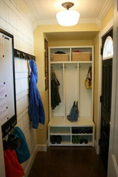 small-space big-function mudroom. love the hooks on the inside sides of the cubbys... room for way more that way.