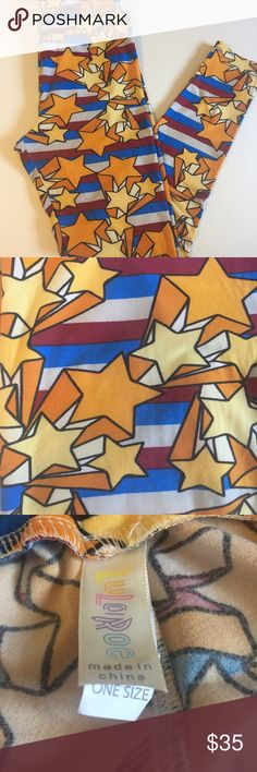 """LLR OS Wonder Woman Leggings ⭐️🦄 Vintage """"Americana"""" LuLaRoe one size stars and stripes leggings. Often referred to as the """"Wonder Woman"""" print. Colors are red, white, blue and golden yellow with black outlines. Would be great for 4th of July too! Worn twice. Great condition. So super soft and stretchy! OS fits sizes 2-10/12.  More LuLaRoe available in my closet! Add your likes to a bundle and I'll send you a private no obligation offer! 💰 LuLaRoe Pants Leggings"""
