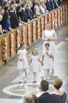 Princess Estelle of Sweden (center) walks with her cousins Chloe and Anais Sommerlath, followed by a relative of Sofia Helqvist - Flowergirls at the wedding of Prince Carl Philip and Sofia Helqvist - 13 June 2015.