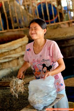 Prahok, the Secret Ingredient of Cambodian Cuisine.  Pictured above: A young woman at the prahok market screws up her nose at the smell of Cambodia's famous fermented fish paste.