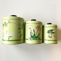 Hand painted vintage canisters in the cheeriest colours!  Discover more fantastic vintage finds at whattheseoldthings.com and whattheseoldthings.etsy.com! #vintage #vintagestyle #vintagehomedecor #vintagedecor #homedecorinspo #designinspo #green #spring #vintagekitchen