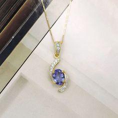 CAPTIVATED BY THIS OVAL TANZANITE DIAMOND SWIRL 18K YELLOW GOLD PENDANT