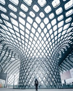 surreal scenes at the bay sports center arena, designed by AXS satow and the beijing institute of architectural design. Modern Architecture Design, Facade Design, Futuristic Architecture, Amazing Architecture, Interior Architecture, Interior Design, Unusual Buildings, Amazing Buildings, The River