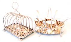 Stunning Antique Breakfast Set, Toast Rack and Egg Cruet Set, Silver Plated Holders with Davenport Imari Pattern Inserts, James Dixon Maker by AToasttothePast on Etsy https://www.etsy.com/listing/224405007/stunning-antique-breakfast-set-toast