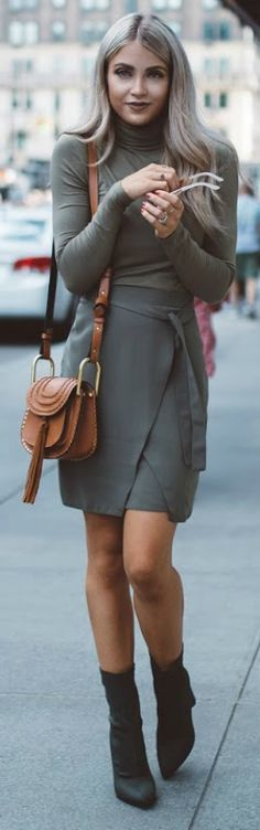 Cara Loren + block booty trend + military green turtleneck + wrap skirt + leather Chloe bag + accents the look perfectly.  Fall Outfits 2016: Bag: Chloe, Boots: Windsor, Skirt: River Island, turtleneck: Asos